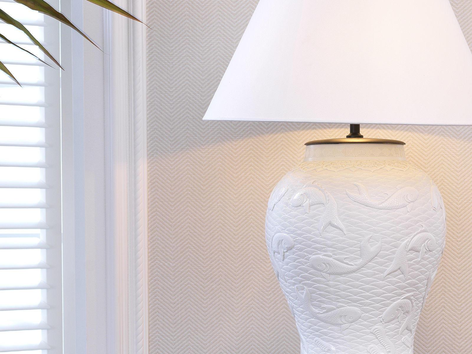Lighting with ceramic detail
